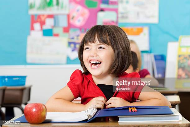 Adorable Laughing Little Girl in Elementary Classroom, Copy Space
