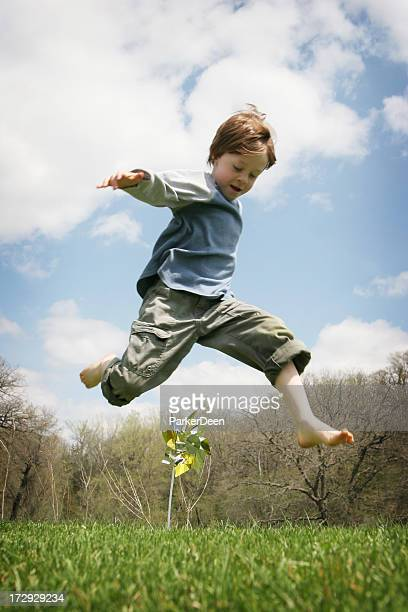 Adorable Little Boy Jumping Over Pinwheel- I Can Fly!