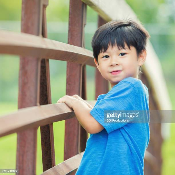 Adorable little boy playing in the park