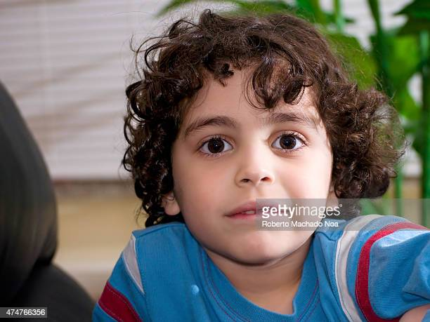 537 Boy With Curly Brown Hair Photos And Premium High Res Pictures Getty Images