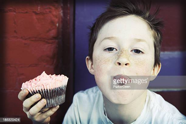 adorable little boy with fancy pink cupcake - kid middle finger stock pictures, royalty-free photos & images