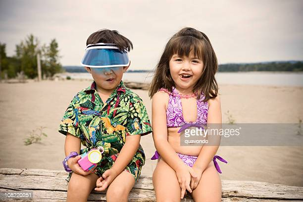 Adorable Little Girl and Boy Kids in Beach Swimsuits, Copyspace