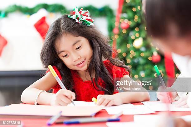 Adorable little girl creates Christmas card
