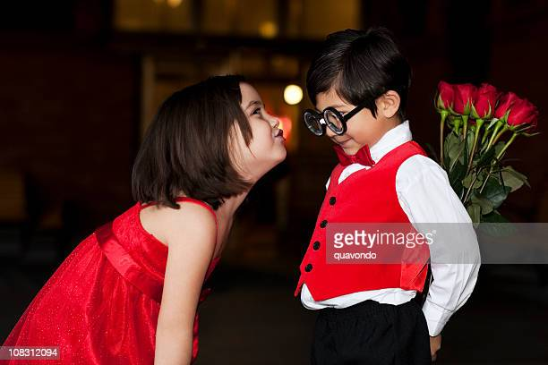 Adorable Little Girl Leans in to Kiss Nerdy Shy Boy