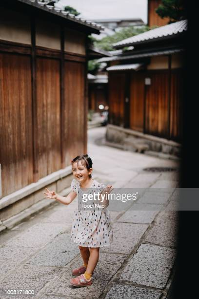 Adorable little girl making a monster face in old street in Kyoto
