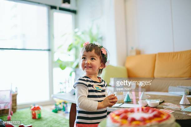Adorable little girl showing excitement with her birthday cake