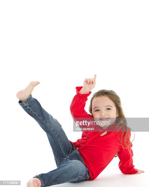 adorable little girl smiling at camera and pointing up - baby pointing stock photos and pictures