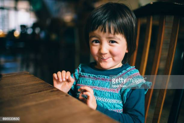 adorable little girl tries coffee for the first time - waist up stock pictures, royalty-free photos & images