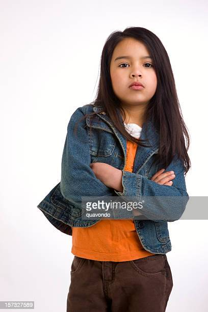 Adorable Mixed Asian Hispanic Girl Crossing Arms Looking Tough