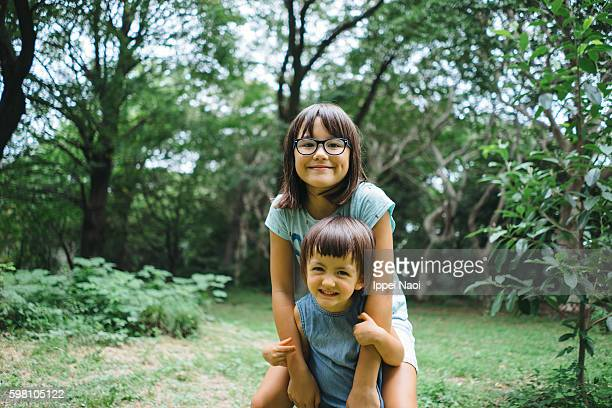 Adorable mixed race children having fun in park