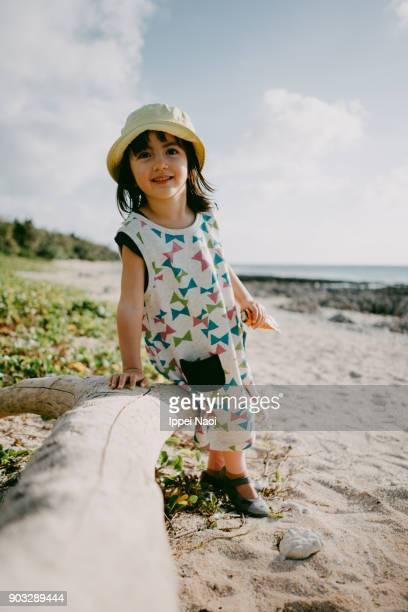 Adorable mixed race girl at beach