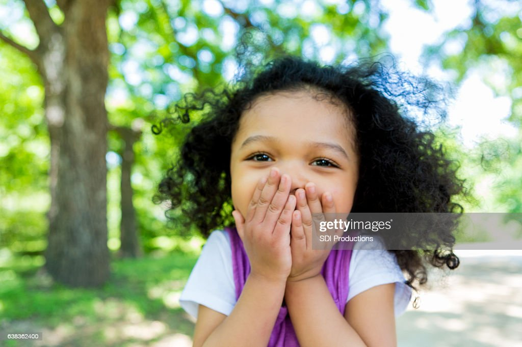 Adorable mixed race girl in the park : Stock Photo