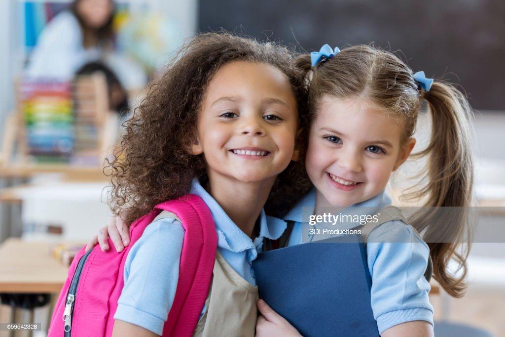 Adorable schoolgirls in class : Stock Photo
