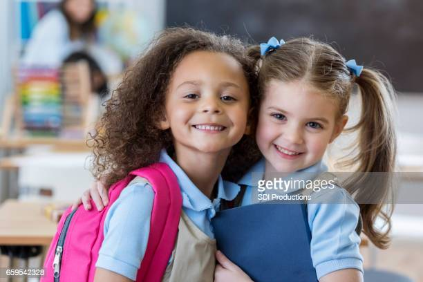 adorable schoolgirls in class - uniform stock pictures, royalty-free photos & images