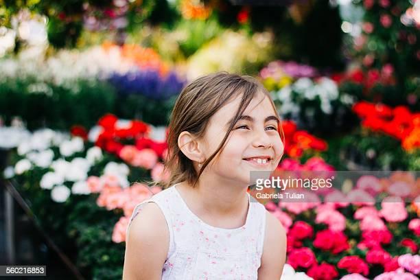 Adorable smiling little girl in springtime