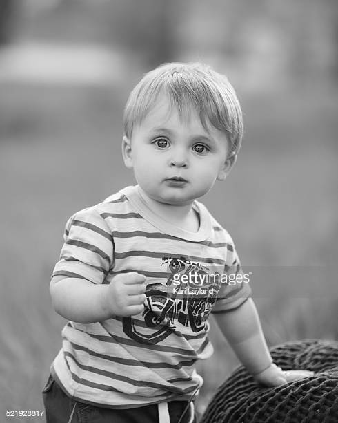 Adorable toddler boy standing