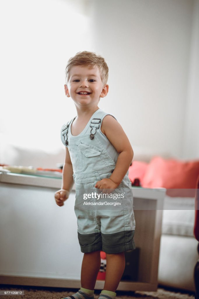 Adorable Toddler Having Fun At Home In Living Room : Stock Photo