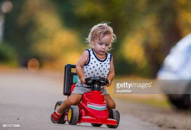 adorable young boy on his motor