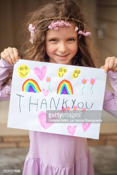 "adorable young girl holding a ""thank you"" sign - illness prevention stock pictures, royalty-free photos & images"