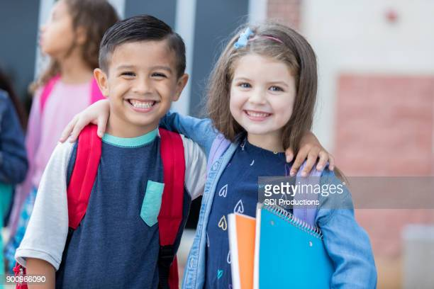 adorable young school friends - first day of school stock pictures, royalty-free photos & images