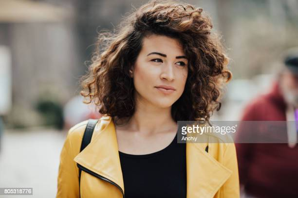Adorable young woman with beautiful curly hair
