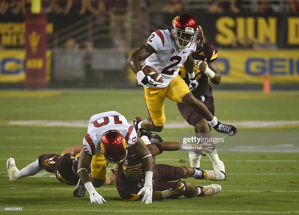 Adoree' Jackson #2 of the Southern California Trojans runs the ball while hurdling a couple players during the first half of a game against the Arizona State University Sun Devils at Sun Devil Stadium on September 26, 2015 in Tempe, Arizona.