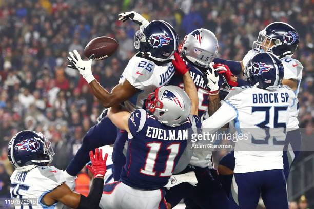 Adoree' Jackson of the Tennessee Titans breaks up the final pass of the second quarter intended for Julian Edelman of the New England Patriots in the...