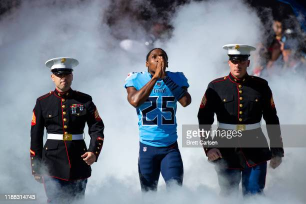 Adoree' Jackson of the Tennessee Titans enters the field with United States Marine Corps members before the game against the Kansas City Chiefs at...