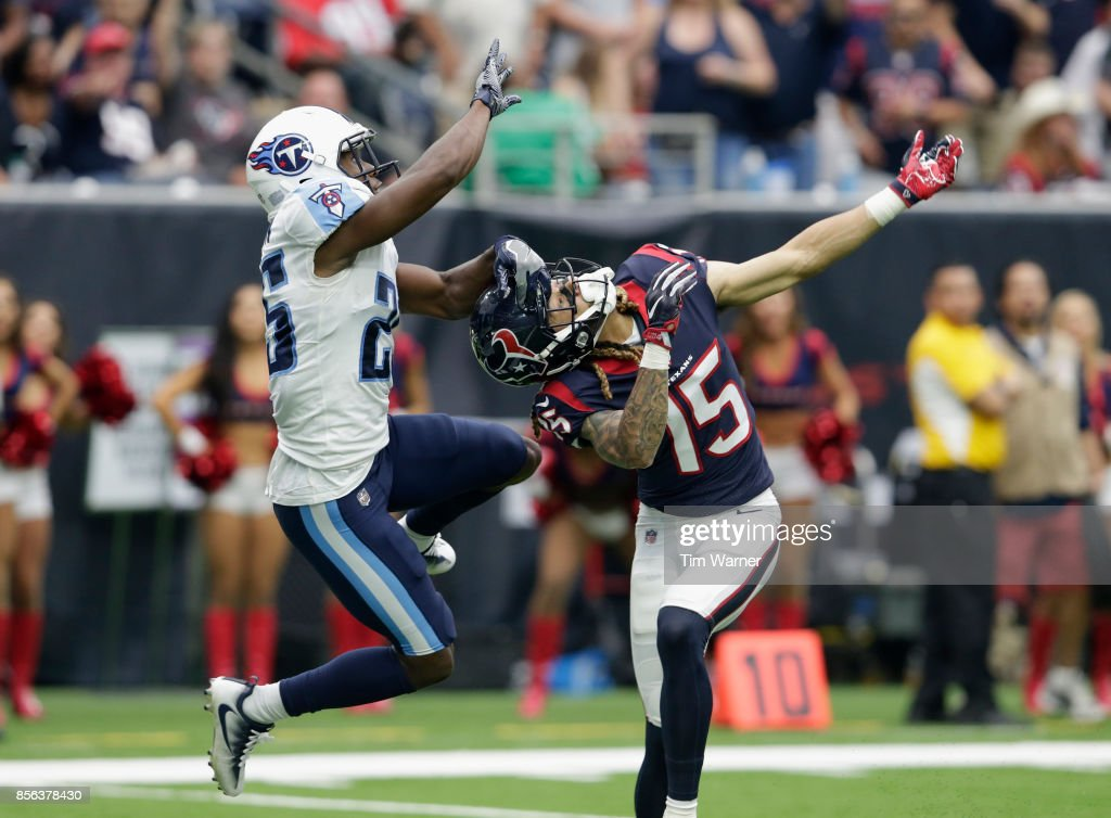 Adoree' Jackson #25 of the Tennessee Titans interferes with Will Fuller #15 of the Houston Texans in the fourth quarter at NRG Stadium on October 1, 2017 in Houston, Texas.
