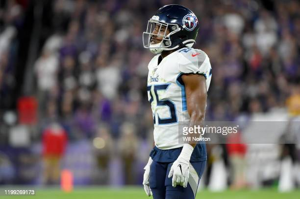 Adoree' Jackson of the Tennessee Titans looks on during the AFC Divisional Playoff game against the Baltimore Ravens at M&T Bank Stadium on January...