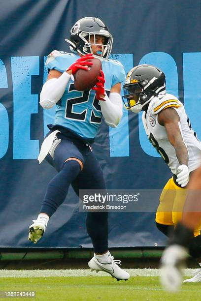 Adoree' Jackson of the Tennessee Titans makes an interception against the Pittsburgh Steelers at Nissan Stadium on October 25, 2020 in Nashville,...