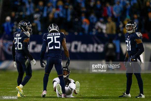 Adoree' Jackson of the Tennessee Titans stands over Donte Moncrief of the Jacksonville Jaguars after tackling him during the fourth quarter at Nissan...