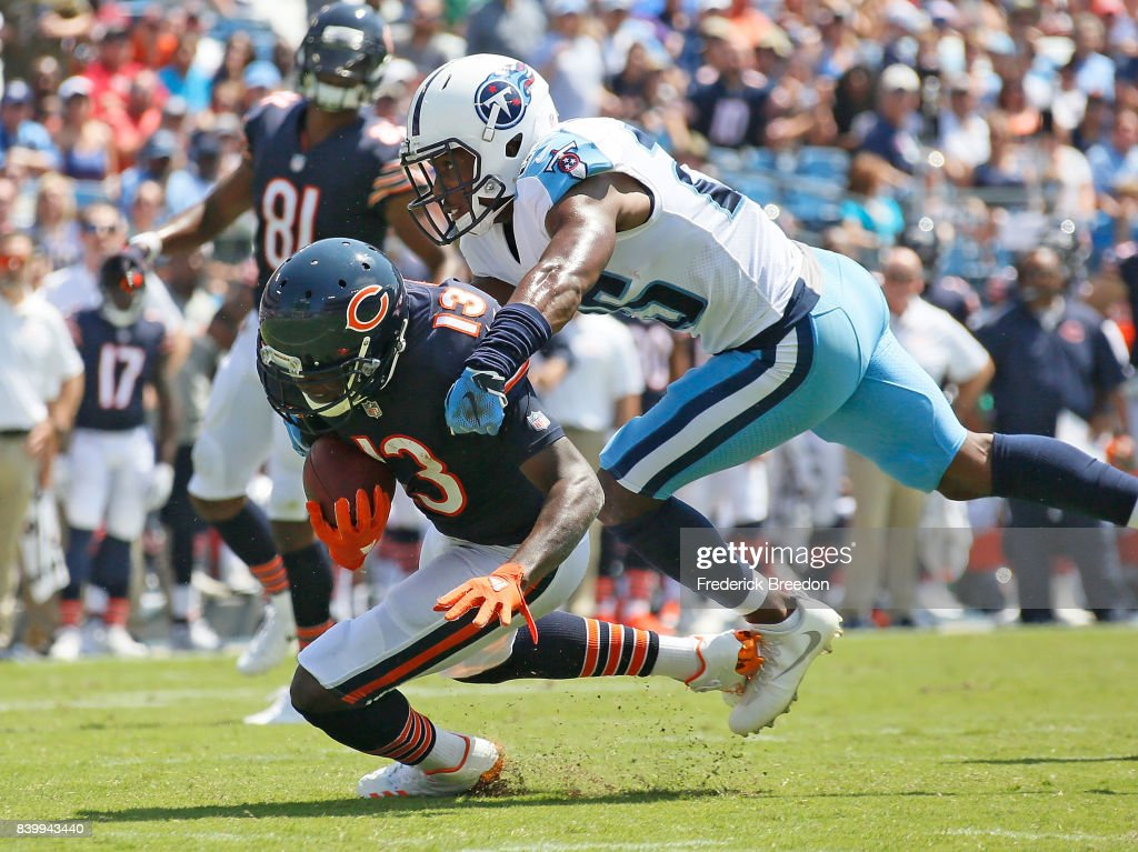 Adoree' Jackson #25 of the Tennessee Titans tackles Kendall Wright #13 of the Chicago Bears during the first half at Nissan Stadium on August 27, 2017 in Nashville, Tennessee.