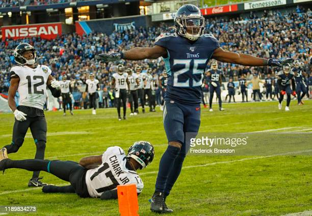 Adoree' Jackson of the Tennessee Titans waves his hands after breaking up a pass attempt to D.J. Chark of the Jacksonville Jaguars at Nissan Stadium...