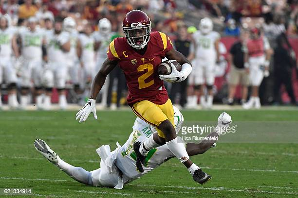 Adoree' Jackson of the USC Trojans carries the ball in the second quarter against the Oregon Ducks at Los Angeles Memorial Coliseum on November 5,...