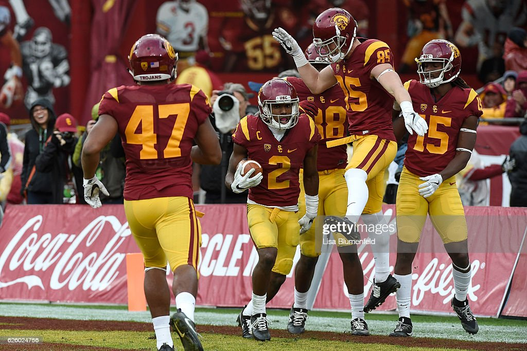 Adoree' Jackson #2 of the USC Trojans celebrates with his teammates after scoring a touchdown in the third quarter against the Notre Dame Fighting Irish at Los Angeles Memorial Coliseum on November 26, 2016 in Los Angeles, California.