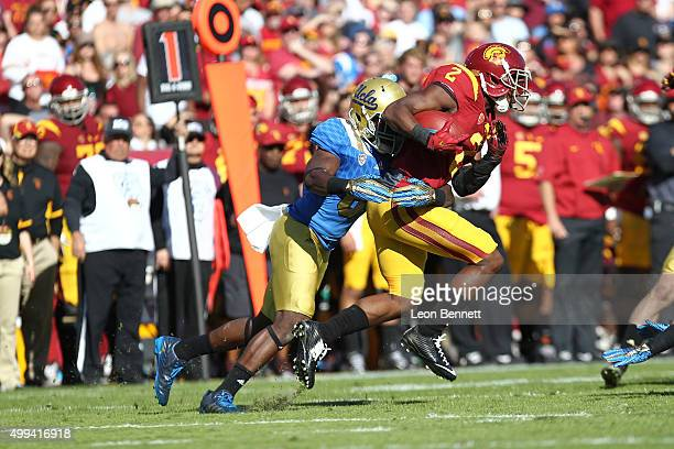 Adoree' Jackson of the USC Trojans is tackled by Adarius Pickett of UCLA Bruins during a 40-21 Trojan win in a NCAA PAC12 college football game at...