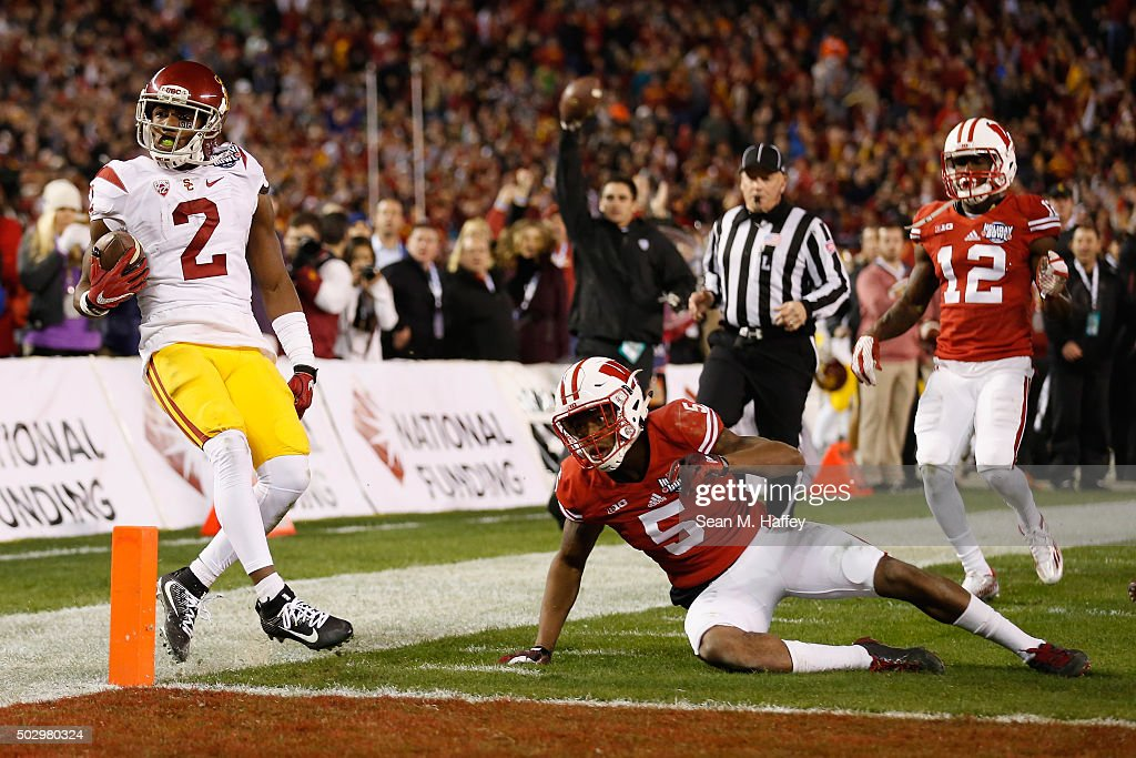 Adoree' Jackson #2 of the USC Trojans reacts after running past Darius Hillary #5 of the Wisconsin Badgers and Natrell Jamerson #12 of the Wisconsin Badgers during the second half of the National University Holiday Bowl at Qualcomm Stadium on December 30, 2015 in San Diego, California.