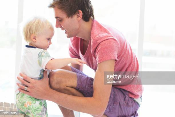 adoring father about to lift his son up to carry him - i love you stock pictures, royalty-free photos & images