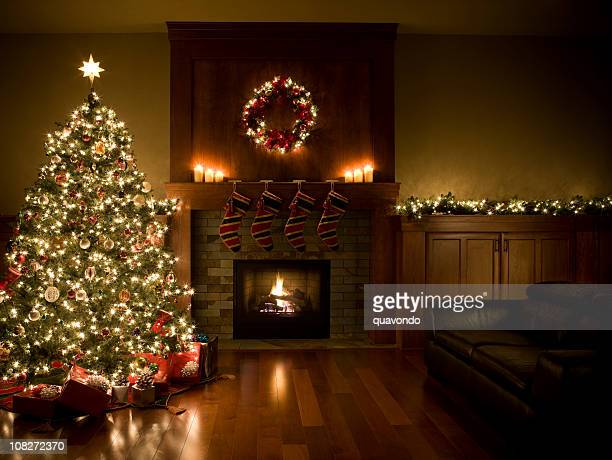 adorned christmas tree, wreath, and garland inside living room, copyspace - christmas tree stock pictures, royalty-free photos & images