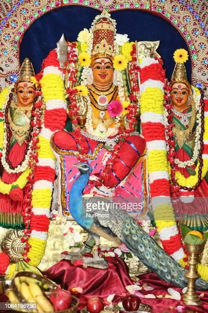 Adorned idol of Lord Murugan and his two wives during the Sooran Por Festival at a Tamil Hindu temple in Ontario Canada on November 13 2018 Sooran...