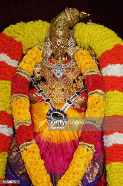 Adorned idol of the Goddess Lakshmi during the Tamil Hindu New Year at a Hindu temple in Ontario Canada