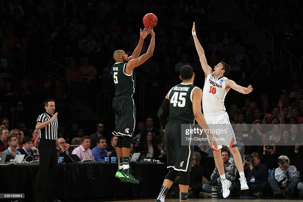 Adreian Payne, Michigan State, shoots a there pointer during the Virginia Cavaliers Vs Michigan State Spartans basketball game during the 2014 NCAA Division 1 Men's Basketball Championship, East Regional at Madison Square Garden, New York, USA. 28th March 2014. Photo Tim Clayton