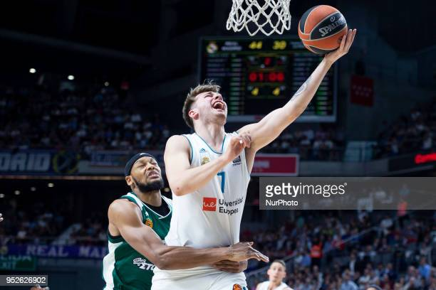 Adreian Payne of Panathinaikos Superfoods in action against Luka Doncic of Real Madrid during the Turkish Airlines Euroleague Play Offs Game 4...