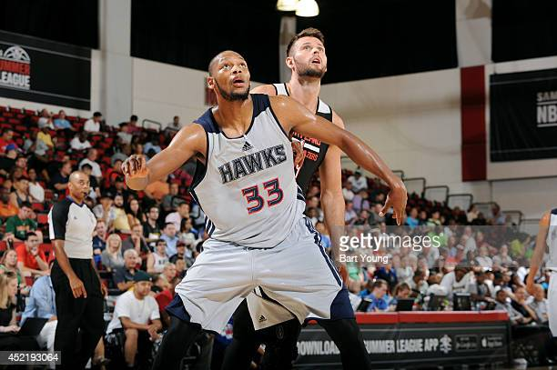 Adreian Payne of the Atlanta Hawks battles for position against Joel Freeland of the Portland Trail Blazers during the Samsung NBA Summer League 2014...