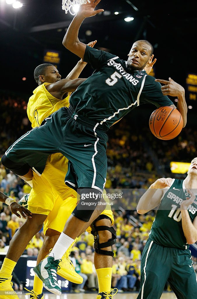 Adreian Payne #5 of the Michigan State Spartans battles for a second half rebound with Glenn Robinson III #1 of the Michigan Wolverines at Crisler Center on March 3, 2013 in Ann Arbor, Michigan. Michigan won the game 58-57.