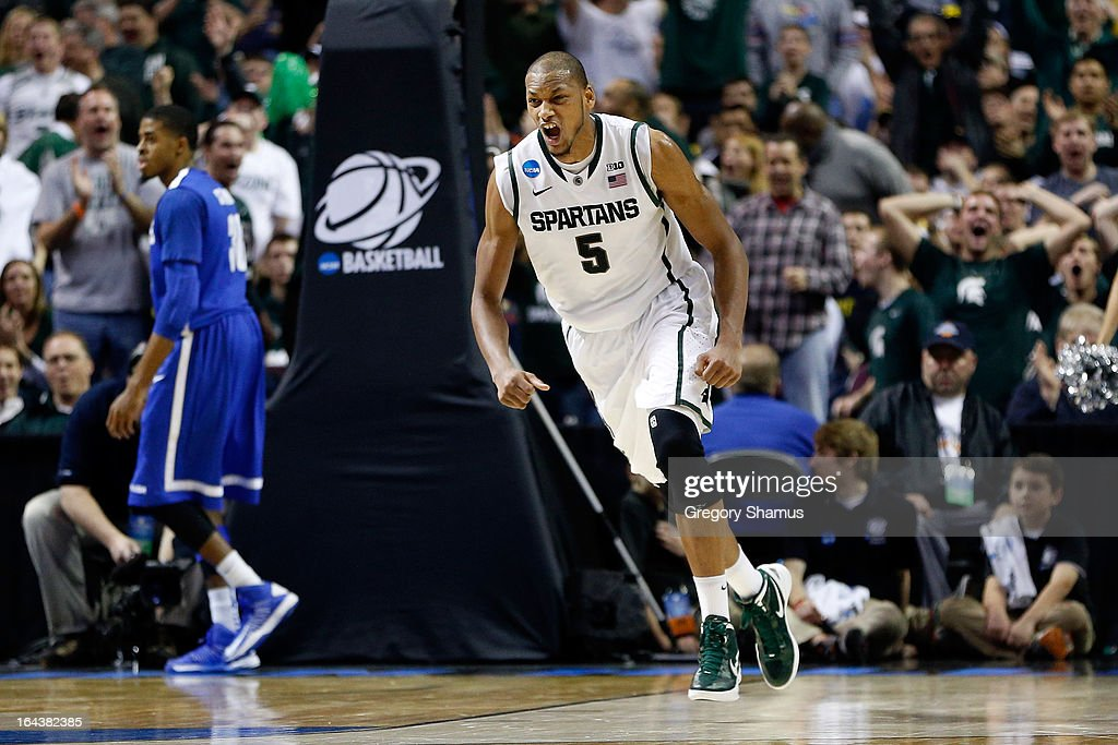 Adreian Payne #5 of the Michigan State Spartans celebrates in the second half against the Memphis Tigers during the third round of the 2013 NCAA Men's Basketball Tournament at The Palace of Auburn Hills on March 23, 2013 in Auburn Hills, Michigan.