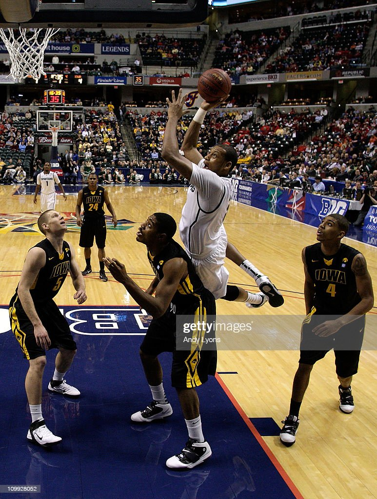 Adreian Payne #5 of the Michigan State Spartans drives for a shot attempt against Melsahn Basabe #1 of the Iowa Hawkeyes during the first round of the 2011 Big Ten Men's Basketball Tournament at Conseco Fieldhouse on March 10, 2011 in Indianapolis, Indiana.