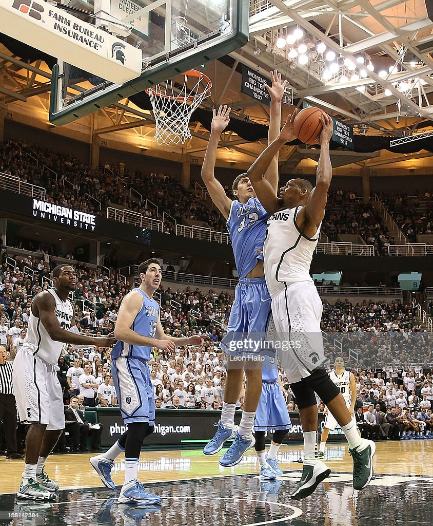 Adreian Payne #5 of the Michigan State Spartans drives the ball to the basket as Chris McComber #32 of the Columbia Lions during the second half of the game at Breslin Center on November 15, 2013 in East Lansing, Michigan. Michigan State defeated Columbia 62-53.