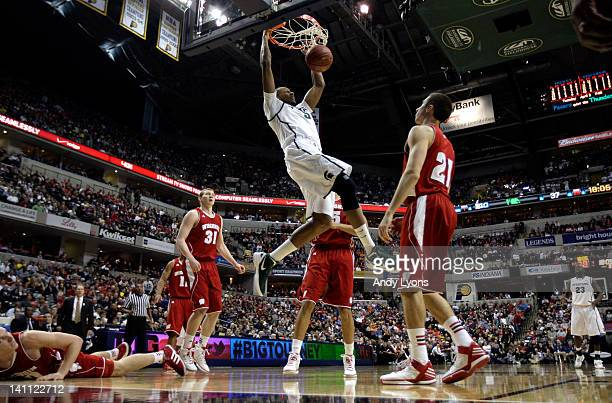 Adreian Payne of the Michigan State Spartans dunks against Josh Gasser of the Wisconsin Badgers during their Semifinal game of the 2012 Big Ten Men's...